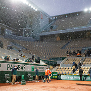 PARIS, FRANCE October 03. Ground staff prepare the clay surface after a rain delay during the Novak Djokovic of Serbia match against Daniel Elahi Galan of Colombia in the third round of the singles competition on Court Philippe-Chatrier during the French Open Tennis Tournament at Roland Garros on October 3rd 2020 in Paris, France. (Photo by Tim Clayton/Corbis via Getty Images)