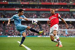 Man City Midfielder Jesus Navas (ESP) is blocked by Arsenal Defender Kieran Gibbs (ENG) - Photo mandatory by-line: Rogan Thomson/JMP - 07966 386802 - 29/03/14 - SPORT - FOOTBALL - Emirates Stadium, London - Arsenal v Manchester City - Barclays Premier League.