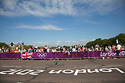 London, UK. Saturday 28th July 2012. On Putney Bridge in London, the crowd prepare for the Men's Team Road Race to pass.