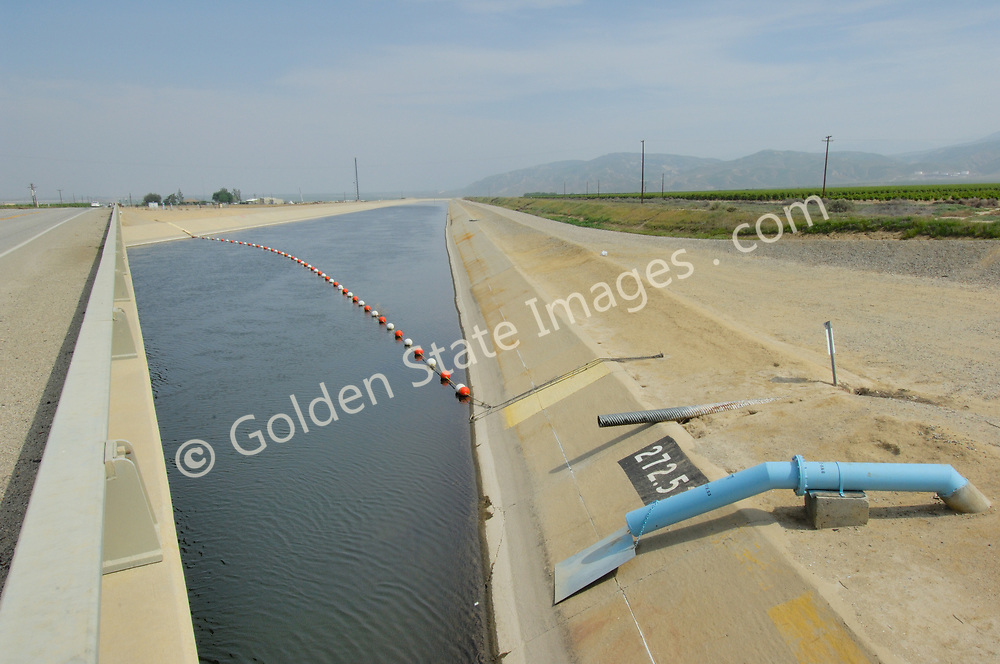 The California Aqueduct is a 444 mile long man made channel that carries water from northern to southern California. A typical section is concrete lined 40 feet wide with an average water depth of 30 feet.<br /> <br /> The California Aqueduct is a key part of the Central Valley Water Project which supplies the water needs of twenty million Californians and more than six hundred thousand irrigated acres of farmland.