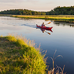 A man kayaking on the North River in Marshfield, Massachusetts. Near Emilson Farm.