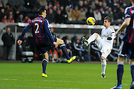 Swansea city's Pablo Hernandez ® is challenged by Stoke's Geoff Cameron. Barclays premier league, Swansea city v Stoke city at the Liberty Stadium in Swansea on Saturday 19th Jan 2013. pic by Andrew Orchard, Andrew Orchard sports photography,
