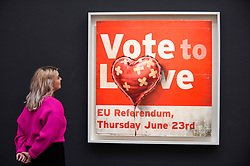 © Licensed to London News Pictures. 07/02/2020. LONDON, UK. A staff member views ''Vote To Love'' by Banksy, (Est. £400,000 - 600,000). Preview of Sotheby's Contemporary Art Sale in their New Bond Street galleries.  Works by artists including Francis Bacon, Yves Klein, Jean-Michel Basquiat and David Hockney will be offered for auction on 11 February 2020.  Photo credit: Stephen Chung/LNP