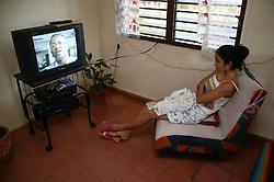 Girl watching television at home in Santa Lucia; Pinar Province; Cuba,