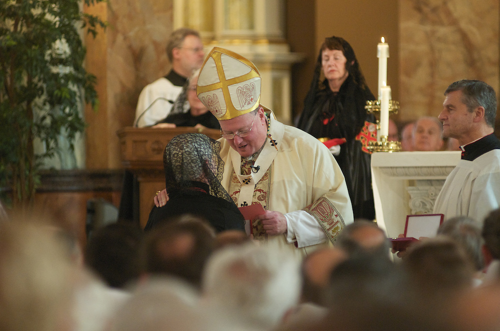 Celebrant Archbishop Dolan proceeds with the Ceremony of Investiture, Sunday Oct. 12 2008. Those Invested included 31 Knights, 29 Ladies, seven Priest Knights, and four Bishop Knights.