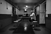 Paul Dupras who is serving a 1 year sentence for parole violation watches television in the common area of section for inmates serving time.  The Bristol County Jail & House of Correction located on Ash Street in New Bedford, Massachusetts was started in 1829, and is the oldest running jail in the United States.   The Ash street jail, as it is known, has been a controversial facility since it opened.  It is believed to be the site of the last pubic hanging in Massachusetts sometime in the 1890's.  Two big riots broke out in the 90's (1993, 1998) and since then the facility has been modified to alleviate some of the crowded conditions that resulted in the riots.