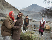 Women go every day to get wood (for cooking and heating) and hay (for animals) in Zor Abad, a winter pasture two hour walk from Hunssaini village, across the Hunza valley riverbed. Gojal region.