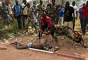 A Central African Army (FACA) soldier stabs the corpse of a man, who was killed as he was accused of joining the ousted Seleka fighters, in the capital Bangui February 5, 2014.