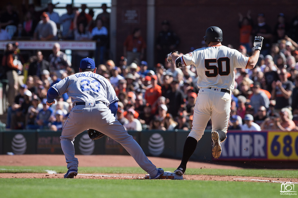 San Francisco Giants starting pitcher Ty Blach (50) beats a throw to first base during a game against the Los Angeles Dodgers at AT&T Park in San Francisco, Calif., on October 1, 2016. (Stan Olszewski/Special to S.F. Examiner)