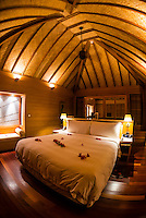 Interior of an overwater bungalow, Four Seasons Resort Bora Bora, French Polynesia.