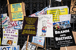 London, UK. 23rd March, 2019. Handmade signs left outside the House of Commons by some of the million protesters who attended the Put It To The People for a People's Vote march and rally.