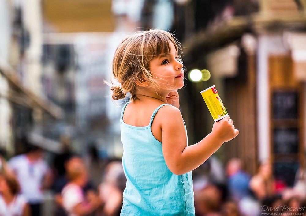 Girl eating an ice cream.