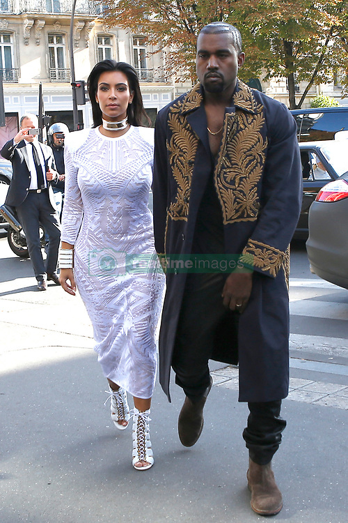 """File photo of Kim Kardashian and husband Kanye West are seen at L'Avenue restaurant where they had lunch with Kris Jenner and Kendall Jenner during the Paris Fashion Week, in Paris, France on September 25, 2014. Kim Kardashian West spoke out about Kanye West's bipolar disorder Wednesday, three days after the rapper delivered a lengthy monologue at a campaign event touching on topics from abortion to Harriet Tubman, and after he said he has been trying to divorce her.Kardashian West said in a statement posted in an Instagram Story that she has never spoken publicly about how West's bipolar disorder has affected their family because she is very protective of their children and her husband's """"right to privacy when it comes to his health."""" Photo by ABACAPRESS.COM"""