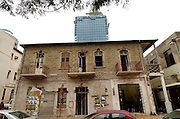 Israel, Tel Aviv An old neglected building with a new modern highrise in the background Rothschild boulevard, December 2005