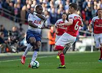 Football - 2018 / 2019 Premier League - Tottenham Hotspur vs. Arsenal<br /> <br /> Moussa Sissoko (Tottenham FC) braces himself as Laurent Koscielny (Arsenal FC) comes in to tackle at Wembley Stadium.<br /> <br /> COLORSPORT/DANIEL BEARHAM