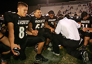 Photo by Alex Jones..Edcouch-Elsa head coach Joe Solis leads the Yellow Jackets, including #87 Javier Rodriguez, in The Lord's Prayer at the end of Friday night's 38-10 playoff loss to New Braunfels Canyon at Buccaneer Stadium in Corpus Christi