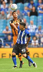 Sheffield Wednesday's Fernando Forestieri battles with Hull City's Eric Lichaj