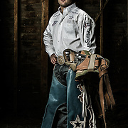UVU student and rodeo bareback star Kaycee Field poses for a portrait in the barn of Robert Taylor of Provo, Utah Friday April 12, 2013. (August Miller)
