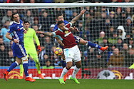 Andre Gray of Burnley and Gary Cahill of Chelsea challenge for the ball. Premier league match, Burnley v Chelsea at Turf Moor in Burnley, Lancs on Sunday 12th February 2017.<br /> pic by Chris Stading, Andrew Orchard Sports Photography.