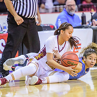 Tohatchi Cougar Kalian Mitchell (5), left, and Dulce Hawk Caitlin Duncan (30) tussle for a loose ball in a District 3A quarterfinal at the Santa Ana Star Center in Rio Rancho Tuesday.