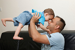 Father and son at home playing.