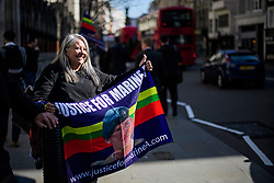© Licensed to London News Pictures.15/03/2017.London, UK.  A supporters of Sergeant Alexander Blackman waiting outside the Royal Courts of Justice in London, before a judge reduced the conviction of Sgt Blackman from Murder to Manslaughter, on appeal.  Also known as Marine A, Sgt Blackman was appealing a life sentence for the murder of a wounded Taliban fighter in Afghanistan in 2011.Photo credit: Ben Cawthra/LNP