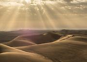 Morning sunrise over the sand dunes in the Lut Desert.