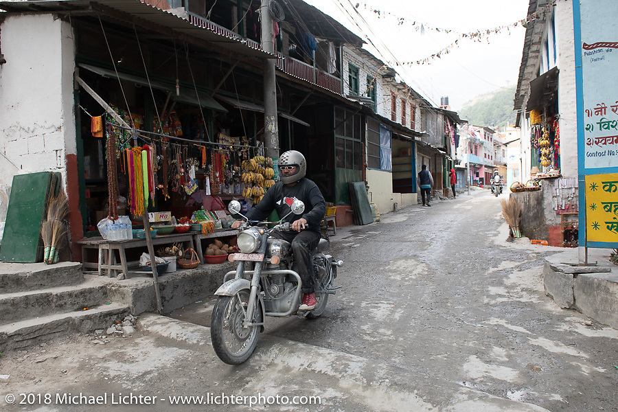 Beanre (Kevin Doebler) passing through Modibeni on Day-7 of our Himalayan Heroes adventure riding from Tatopani to Pokhara, Nepal. Monday, November 12, 2018. Photography ©2018 Michael Lichter.