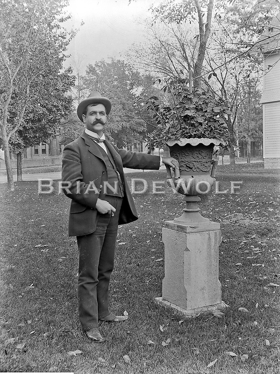 Man's identity unknown.<br /> Possible location is behind Gamon Corner house. Is the Newton House off of his left shoulder? If this is correct, that is Wilson Street just west of Rt. 31 (Batavia Ave.).