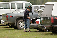 A Union soldier adjusts his uniform in the parking lot during a Civil War reenactment hosted by the 124th New York State Volunteers at the Orange County Farmers Museum on Sept. 23, 2006.