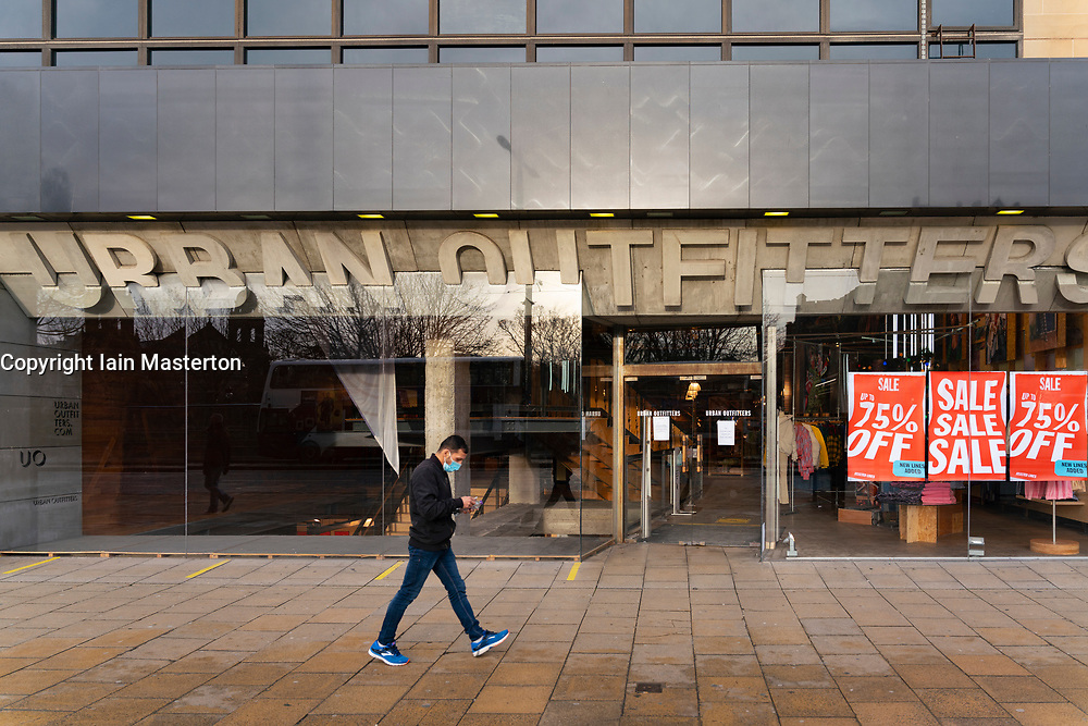 Edinburgh, Scotland, UK. 28 December 2020. Scenes from Edinburgh City Centre as Scotland starts first weekday under the most severe level 4 lockdown with all non-essential businesses closed. Pic; Urban Outfitters  store closed on Princes Street. Iain Masterton/Alamy Live News
