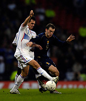 Photo: Jed Wee.<br />Scotland v France. UEFA European Championships 2008 Qualifying. 07/10/2006.<br /><br />France's Willy Sagnol (L) tries to win the ball from Scotland's James McFadden.