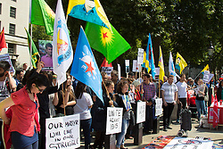 London, July 25th 2015. Hundreds of Kurds and their supporters protest against ISIS, following the suicide bombing in Suruc which claimed the lives of 32 people, and the Turkish government of Recep Tayyip Erdoğan, which they claim is assisting ISIS in their ongoing campaign against the Kurds who have been running an insurgency to set up an independent Kurdish state.