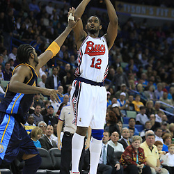28 January 2009:  New Orleans Hornets center Hilton Armstrong (12) shoots over Denver Nuggets center Nene Hilario (31) during a 94-81 win by the New Orleans Hornets over the Denver Nuggets at the New Orleans Arena in New Orleans, LA. The Hornets wore special throwback uniforms of the former ABA franchise the New Orleans Buccaneers for the game as they honored the Bucs franchise as a part of the NBA's Hardwood Classics series. .