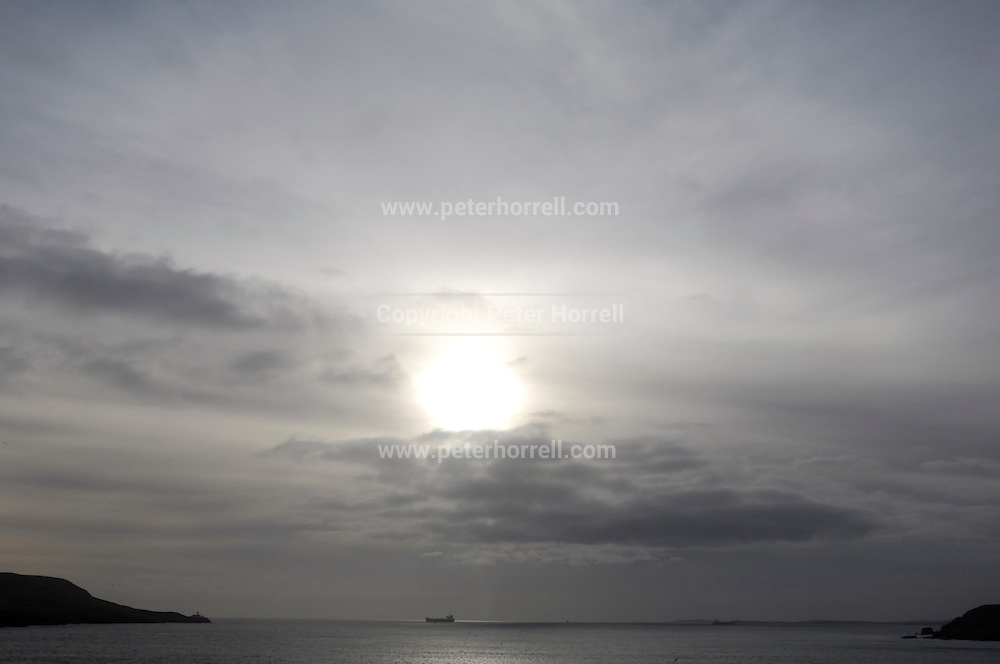 Tuesday 29th January 2013: View from Lerwick of a ship passing Bressay Lighthouse. Copyright 2013 Peter Horrell