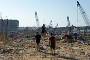 People are seen wandering through debris on a residential outskirt, devastated by an explosion at the Port of Beirut on Saturday, Aug 22, 2020, nearly 3 weeks after the explosion that devastated the city. (VXP Photo/ Matt Kynaston)