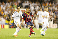 Real Madrid´s Di Maria (L) and F.C. Barcelona´s Adriano during the Spanish Copa del Rey `King´s Cup´ final soccer match between Real Madrid and F.C. Barcelona at Mestalla stadium, in Valencia, Spain. April 16, 2014. (ALTERPHOTOS/Victor Blanco)