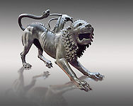 """Etruscan bronce statue of the mythical Chimera known as the  """"Chimera of Arezzo"""" from the St Lorentino Gate of Arezzo, made end of 5th - early 4th century B.C, inv no 1,  National Archaeological Museum Florence, Italy , against grey .<br /> <br /> If you prefer to buy from our ALAMY PHOTO LIBRARY  Collection visit : https://www.alamy.com/portfolio/paul-williams-funkystock - Scroll down and type - Etruscan Florence - into LOWER search box. (TIP - Refine search by adding a background colour as well).<br /> <br /> Visit our ETRUSCAN PHOTO COLLECTIONS for more photos to download or buy as wall art prints https://funkystock.photoshelter.com/gallery-collection/Pictures-Images-of-Etruscan-Historic-Sites-Art-Artefacts-Antiquities/C0000GgxRXWVMLyc"""