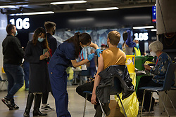© Licensed to London News Pictures.  20/06/2021. London, UK. A members of the public is being vaccinated at Tottenham Hotspur Stadium, north London where Covid-19 vaccines are being offered to all adults over the age of 18. Photo credit: Marcin Nowak/LNP