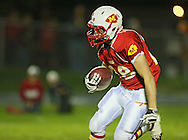 Marion's Colton Mowry (28) runs with the ball a kickoff during the first half of the game between Maquoketa and Marion at Thomas Park Field in Marion on Friday, September 21, 2012.