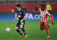 Olympiakos' Michael Olaitan and Manchester United's Shinji Kagawa battle for the ball