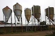 Steel animal feed hoppers on a farm, Sutton, Suffolk, England