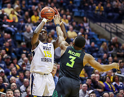 Jan 21, 2019; Morgantown, WV, USA; West Virginia Mountaineers forward Lamont West (15) shoots a three pointer over Baylor Bears guard King McClure (3) during the second half at WVU Coliseum. Mandatory Credit: Ben Queen-USA TODAY Sports