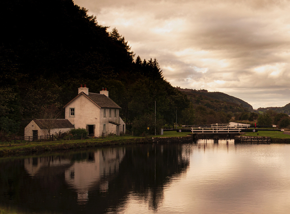 Short but endlessly picturesque, the Crinan Canal joins Loch Fyne with the Sound of Jura. James Watt was engaged in its survey and the renouned stonemason, Telford contributed to its engineering . The lock keepers' houses nestle against the banks. The labourious work is now substantially mechanized.