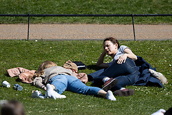 © Licensed to London News Pictures. 17/04/2021. London, UK. Members of the public relax and enjoy the sunny weather in Hyde Park in central London. Temperatures are expected to rise with highs of 16 degrees forecasted for parts of London and South East England later this week . Photo credit: George Cracknell Wright/LNP