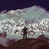 HIMALAYA, NEPAL. Meredith Wiltsie (MR) in Annapurna Sanctuary, below South Face of 8,091 meter (26,545') Annapurna I, world's 10th highest peak .