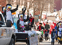 Happy Penguins on board the Bank of New Hampshire float during Laconia's annual Holiday Parade Saturday morning.  (Karen Bobotas/for the Laconia Daily Sun)