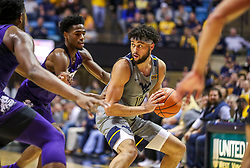 Jan 14, 2020; Morgantown, West Virginia, USA; West Virginia Mountaineers guard Jermaine Haley (10) looks to pass while guarded by TCU Horned Frogs guard RJ Nembhard (22) during the second half at WVU Coliseum. Mandatory Credit: Ben Queen-USA TODAY Sports