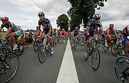US Postal Service teammates Lance Armstrong (right) and George Hincapie enter the town of St. Feyre near the end of Stage 9 of the Tour de France on Tuesday...7/13/04.Alex Jones/For American-Statesman