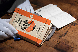 "© Licensed to London News Pictures. 26/10/2018. LONDON, UK. A technician presents ""The Judge's copy from the 1960 obsecenity trail, annotated by him and his wife"", D.H. Lawrence's Lady Chatterley's Lover (Est GBP10,000-15,000).   Preview of ""A Private View, property from the country home of Christopher Cone and Stanley J. Seeger"" at Sotheby's, New Bond Street.  Over 200 extraordinary works will be auctioned in London on 30 October 2018.  Photo credit: Stephen Chung/LNP"